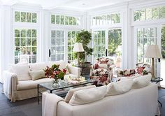 Three walls of sliding glass doors are topped with transoms, all contributing to the wonderful light
