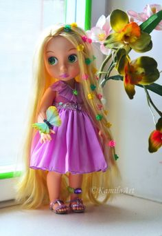 A little golden-hair princess Rapunzel Disney Animators Collection