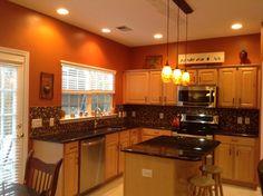 Burnt orange kitchen with new lighting!