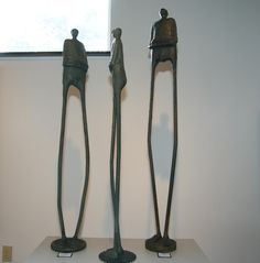 """Real Men""  sculpture    concrete and steel by Deb McColley"