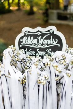 Have your guests send you off on your honeymoon by waving these adorable ribbon wands. Such a fun touch! Aldridge Gardens Pavilion Reception. Photo credit Morgan Trinker.