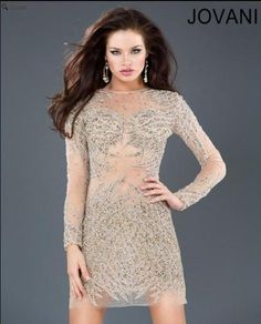 #Jovani style 72718 is a stunningly attractive nude illusion and beaded mini long sleeved dress that gives the illusion that you have stones and beading covering your body. This dress is a must have. http://www.jovani.com/short-cocktail-dresses/jovani-72718-112200