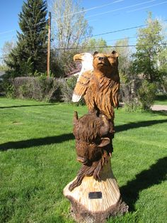 Animal Wood Log Carvings | Wood carvings Wooden nickels Pegboard Ship masts and yardarms Toilet ...