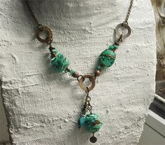 this necklace on natural brass chain has my lampwork in really green, I would say just emerald green - together with chrysoprase, some vintaj components and more Its a long one, has a closure but you can also pull it over your head.... this necklace is ready to ship My beads are