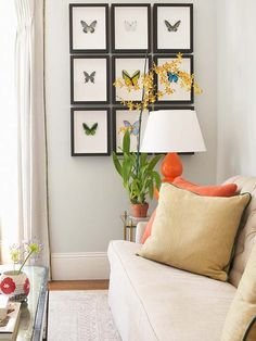 Bring the great outdoors inside with artwork. This sunny sitting room includes a large bay window that offers magnificent views of the outside, making these small butterfly prints blend right in on a blank wall. The bright colors on the butterflies' wings add a needed splash of color to the mostly neutral room and coordinate perfectly with other accessories and decor.
