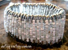 artsy-fartsy mama: Safety Pin Bracelet What you'll need:   100+ medium safety pins (make sure pins have both top & bottom holes - see photo of pins below) 1 package Seed Bead mix, or a few if you want to mix colors   Elastic cord or clear Stretch Magic     Pliers