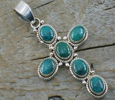 Love the Dark Blue-Greenish color!.....Turquoise Pendant 6-Stone Cross from The Turquoise Mine