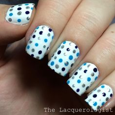 Polka dots are often overlooked, but they're such an easy nail art technique that anyone can master, and when you incorporate more than one color for the dots, it's even cooler. To get this look from Emily of The Lacquerologist, start with two coats of an opaque white polish. Use a toothpick or dotting tool to create small dots with silver, light blue, and dark blue—or any colors you like.
