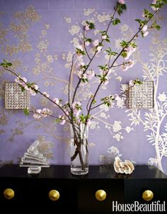 Vintage Austrian crystal sconces sparkle against the glow of silver in the wallpaper.