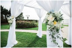 Chuppah at the Island House and Goat Island Newport. Designed by Toni Chandler Flowers & Events. #BelleMer