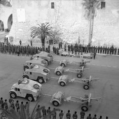 25-pdr field guns and 'Quad' artillery tractors parade past Winston Churchill during his visit to Tripoli to thank the 8th Army for its succ...
