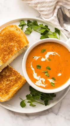 This Creamy Tomato Soup is made in 20 minutes with canned tomatoes, but no one would ever know! It& flavored with basil, garlic and Parmesan and perfect for dunking your grilled cheese! Crock Pot Recipes, Tomato Soup Recipes, Easy Soup Recipes, Lunch Recipes, Easy Dinner Recipes, Vegetarian Recipes, Chicken Recipes, Easy Meals, Cooking Recipes