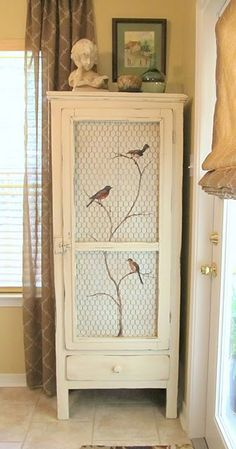 Love the bird stencil and chicken wire on this cabinet - would look perfect on my lil' cabin pantry