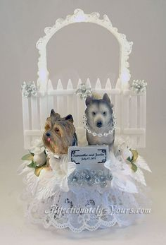 Customized dog wedding cake topper with husky bride and yorkie groom.  White with silver accents. Includes personalized name and date plate.  http://www.affectionately-yours.com/pedigree-nuptials-dog-cat-bride-groom-wedding-cake-topper/