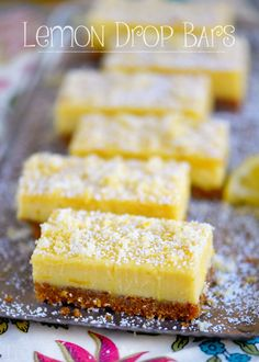 These Lemon Drop Bars are extra creamy and topped with candied lemon zest for the BIGGEST lemon flavor possible! So easy to make, deliciously sweet and tart, you'll find these Lemon Drop Bars hard to resist! Lemon Dessert Recipes, Lemon Recipes, Baking Recipes, Cookie Recipes, Lemon Cheesecake Bars, Lemon Bars, Cake Simple, Lemon Biscuits, Drop Cake