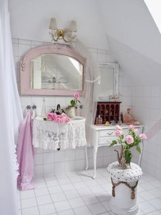 Charming bathroom decorated with white tiles and pink accessories - shabby chic decor Live the lace sink skirt!