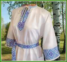 Womens dress Svarga. In the embroidery symbols of the Slavic gods Svarog and Perun were used. The symbols are inside the lattice of Orepey. These are the signs of the birth of the Divine. Symbols have an ancient historical origin, are found everywhere in Russia and the world.  Belt