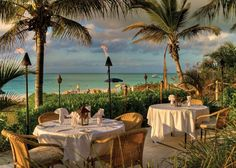 A photograph of Grace Bay Beachfront Dining at Bay Bistro at Sibonne Beach Hotel, Providenciales (Provo), Turks and Caicos Islands.