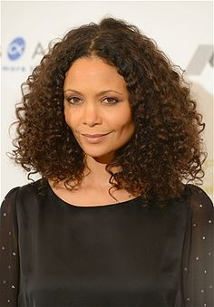 Let it loose! Thandies shoulder-length cut helps her natural curls frame her face, not overshadow it.