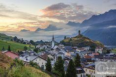 Misty sky on the alpine village of Ardez at sunrise, district of Inn, Lower Engadine, Canton of Graubunden, Switzerland, Europe