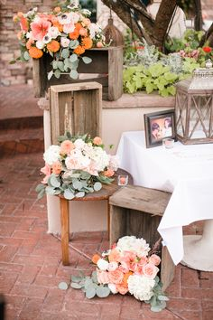 Tumbling crates filled with florals at the guest book table