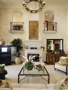 Living Room Balconies: The fireplace in the family room is bookended by two Juliet balconies. This would be so nice for pictures if you had a daughter ;)