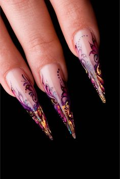 I love stiletto nails. Not very practical but striking as hell.