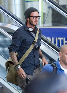 David Beckham.. Flannel Shirt and Burton beanie..