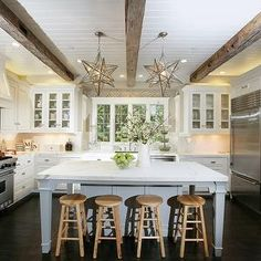 love these morovian star pendants for over an island, love the beams, cabinets, etc etc. beautiful.