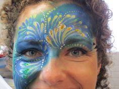 pauw face paint  geschminkt door Annemiek  www.schminkenisleuk.nl