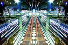 """Graffiti of Speed / Mirror Symmetry"" is a project the Japanese photographer Shinichi Higashi who captured the stunning pictures of speedy cityscape of Tokyo by combining symmetrical and long exposure techniques."
