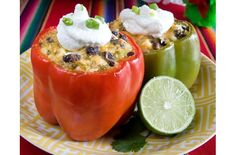 Tamale Stuffed Peppers | Instead of cornmeal on the outside the peppers are filled with a scrumptious cornmeal stuffing of tomatoes, beans, corn, enchilada sauce, cheese and more!