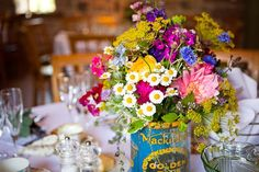 Bright & colourful reception table centrepieces in a vintage tin. Beautiful...