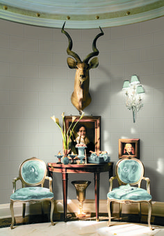 "thedecorista: "" taxidermy takes center stage here….Personally, I would omit the sconce-love the vignette. """