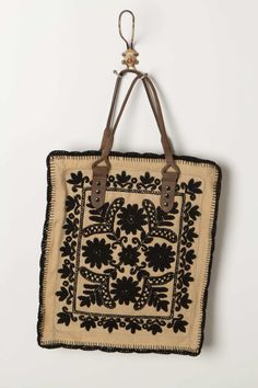 Framed Needlepoint Tote.   I wish I had bought this. #anthrofave #juvenilehalldesign