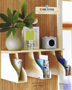 IKEA hack:  a small shelf and 3 magazine holders fixed using brackets and screws can be put together for a mail station. #DIY