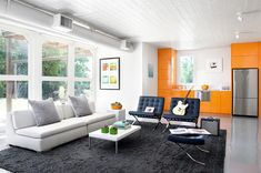 Using the Pantone trend, orange, wisely in your house: white orange home interior color design by Poteet Architects House Color Schemes Interior, Interior Wall Colors, Colorful Interior Design, Modern Home Interior Design, Best Interior, Orange Kitchen Designs, Living Room Orange, Office Interiors, Modern Interiors