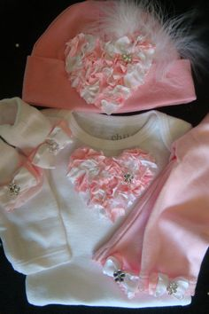 NEWBORN baby girl take home outfit complete with oversized pink heart onesie, matching pants, hat and socks. $40.00, via Etsy.