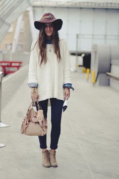 wool hat, white sweater, denim shirt, jeans, and sand boots