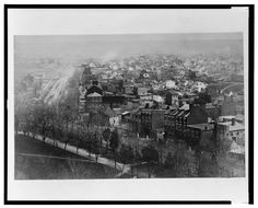 Southeast view with Pennsylvania Ave. to the left and the Capitol grounds, A Street, and B Street (i.e., Independence Ave.) in the foreground; view includes the Wallach School and St. Peter's Catholic Church. 1863