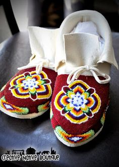 They are a women's size 9 beaded moccasins, sewn onto white German tanned deer hide. From Creative Native Boutique, Navajo artist.