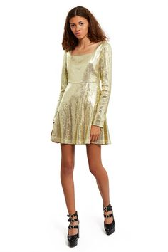 Eric Schlösberg, Gold Tea Party Dress Eric Schlösberg's Fall/Winter 2017 collection is Alice's Adventures in Wonderland set in 1980s New York City. This A-line mini dress is made from dazzling gold-tone sequins and is finished off with a square neck and long-sleeves., Hidden back zipper closure, Mid-thigh length, Dry clean only, 100% silk sequins, Made in USA