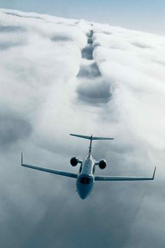 A Gulfstream cutting through clouds.  Real or Photoshop?