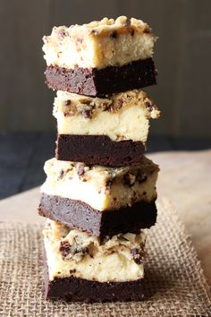 Outrageous Brownie Bottom Cookie Dough Cheesecake Bars have a layer of fudgy brownie, cheesecake filling, and a chocolate chip cookie dough topping.