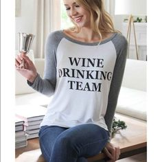 WINE DRINKING TEAM Baseball Sleeve Shirt! So cute for the wine lover. WINE DRINKING TEAM written in black letters stand out on this long sleeve baseball tee. Pair with jeans and a necklace for a fresh look. So great for girls' night or bachelorette parties! Show your excitement for drinking wine later in this fun top!   This top is not lined and is slightly see through. A seamless tank is highly recommended for coverage.   Available in size small, medium or large.   95% Rayon 5% Spandex…