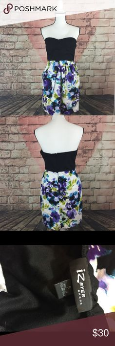 "IZ BYER Floral strapless dress size 9 This IZ Byer women's Floral strapless dress is a size 9 . The measurements are across the bust 15.5 "" and the length is 27"" Iz Byer Dresses Strapless"