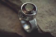 aum ring, silver + imperial topaz