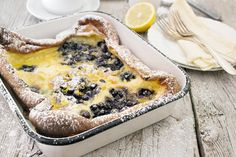 Delicious Finnish breakfast pancake known as pannukakku. Topped with wild blueberries, flavoured with lemon zest and topped with blueberry maple sauce.