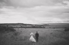 A bride and groom stepping away from the safety of the vehicle during a safari wedding portrait session in Kenya.