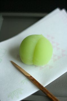 "青梅 ""Aó-umé"" (lit. green umé or unripe plum) motif early summer wagashi from ""Toshimaya"" famous for its Hato Saburē (pigeon shaped long selling shortbread cookies). ☆鳩サブレで有名な豊島屋の上生菓子「青梅」。★5 shops including Komachi Branch (Kamakura City, Kanagawa Pref.) & its surroundings. 神奈川県鎌倉市小町店を含め、周辺に5 店舗。"